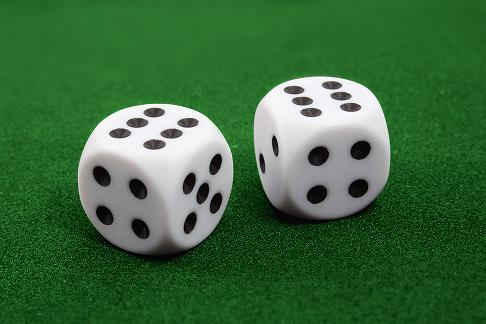 Two dices on green surface
